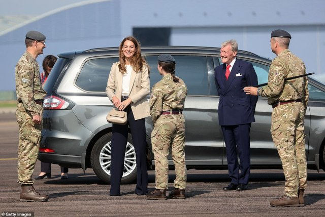 Kate smiles as she arrives at Brize Norton today to meet those who supported the UK's evacuation of civilians from Kabul