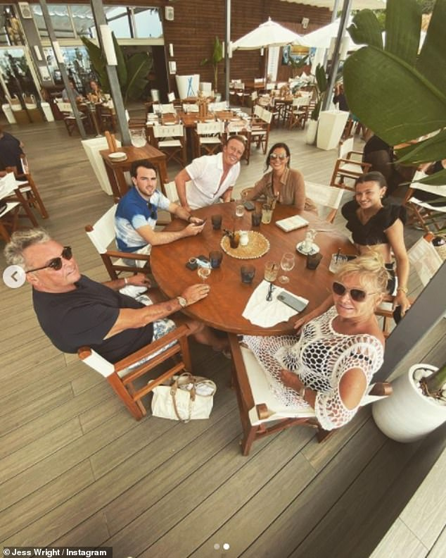 Family: The TOWIE star also shared a beautiful photo of her family members having lunch together in the sun