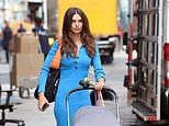 Emily Ratajkowski cuts a chic figure in blue knit dress with statement orange handbag in NYC