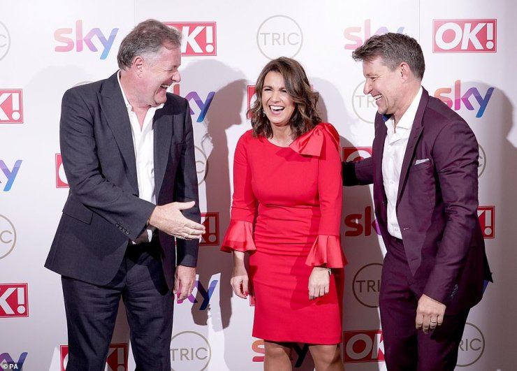 Fun: Susanna - who looked incredible in a red cocktail dress - looked like she was having a great time chatting to Piers