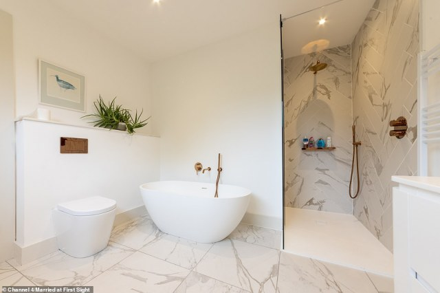Despite the heritage of the site, the couple revamped the space into a gorgeous modern family home (pictured, one of the four bathrooms)