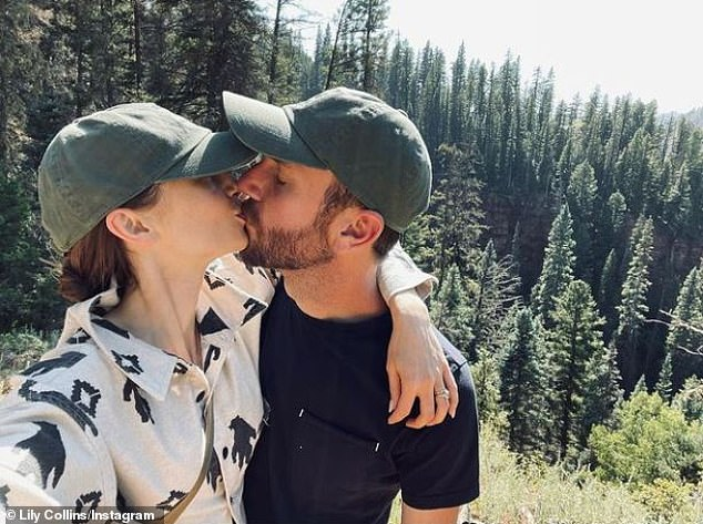 Wedded bliss: Newlyweds Lily Collins and Charlie McDowell are clearly enjoying their honeymoon in the woodsy PDA snap she shared on Wednesday