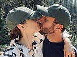 Newlyweds Lily Collins andCharlie McDowell kiss in matching hats during honeymoon