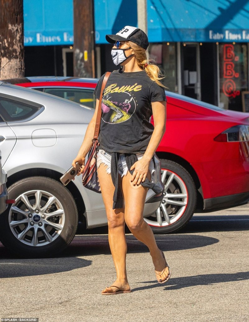 She kept it casual as she recovers from her overdose in a David Bowie T-shirt, short denim cutoffs, sandals and sunglasses