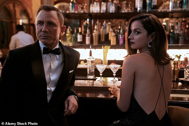 Old times: MI5 agent Bond has bedded a string of beautiful women, with his sexuality never in doubt until the inclusion of Skyfall's famous scene