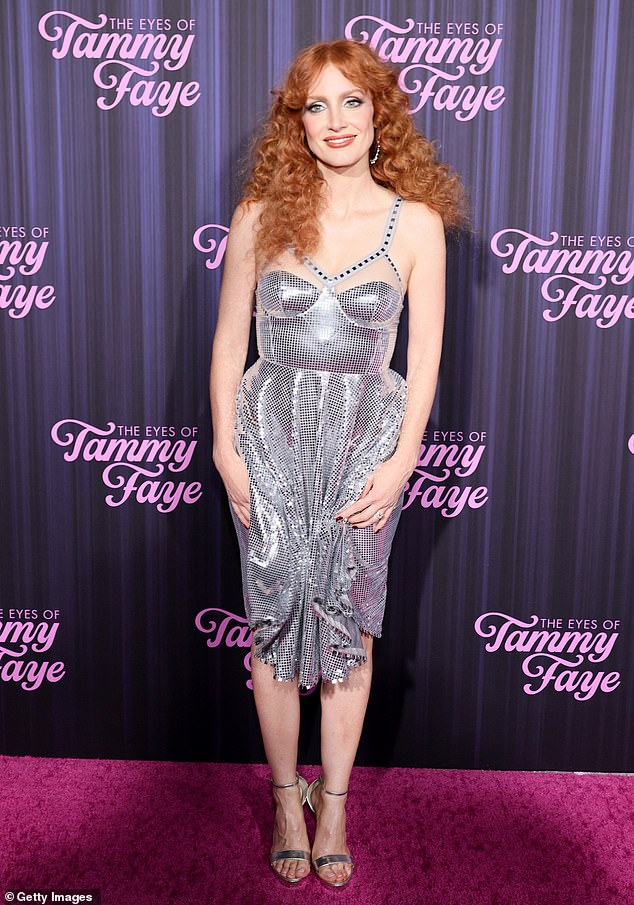 The night before:Jessica walked the red carpet at The Eyes of Tammy Faye premiere in a glitzy disco-era mirrored dress and silver high heels with her hair teased in a 70s curls