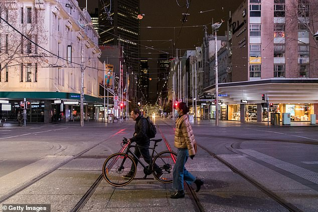 Beleaguered Melburnians trapped in their sixth Covid lockdown will finally get some much-need relief, and even the hated curfew may be coming to an end (pictured, Melburnians walk the eerily empty city under lockdown)