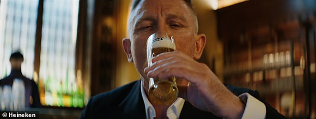 Satisfaction: The actor was seen pausing for a sip of the lager in the promo as an ode to 007 fans who have patiently been waiting for the film