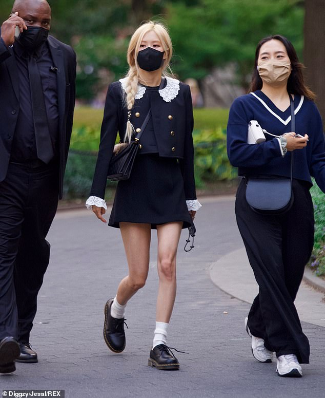 Leggy: The 24-year-old K-pop star looked chic in a black cropped double-breasted blazer featuring a white lace Peter Pan collar, matching mini-skirt, and $120 Dr. Martens Oxfords