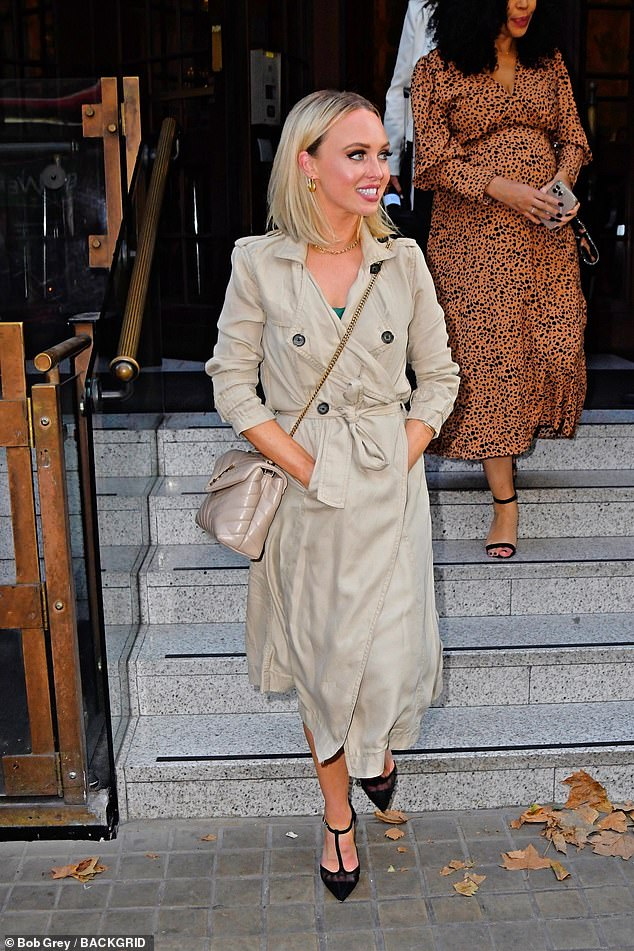 Pearly whites: The television personality flashed a smile as she left the London venue, showing off her gleaming white teeth