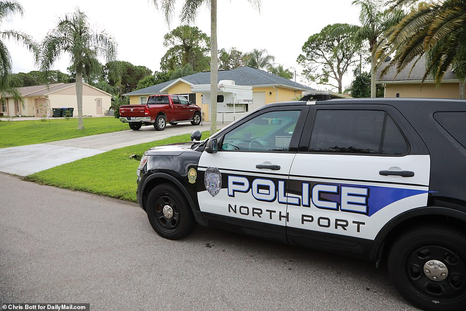 Police are seen outside the Laundrie family home in North Port, Florida, where Brian Laundrie returned in the couple's van without Gabby after their trip