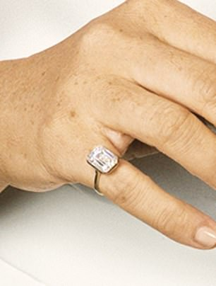 Unique: On her right hand, Meghan wore what is believed to be a custom-made pinky ring that was reportedly designed by jeweler Lorraine Schwartz, according to Page Six