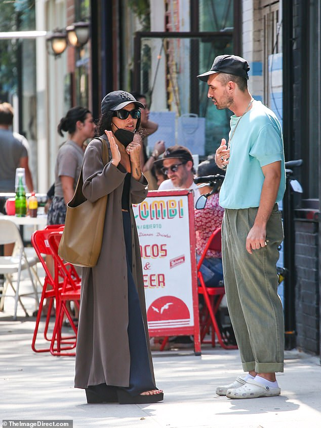 Style star:The perennially chic daughter of Lisa Bonet and Lenny Kravitz Zoe met up with pal in Manhattan sporting a long trench coat, wide-leg trousers and foam platform flip flops