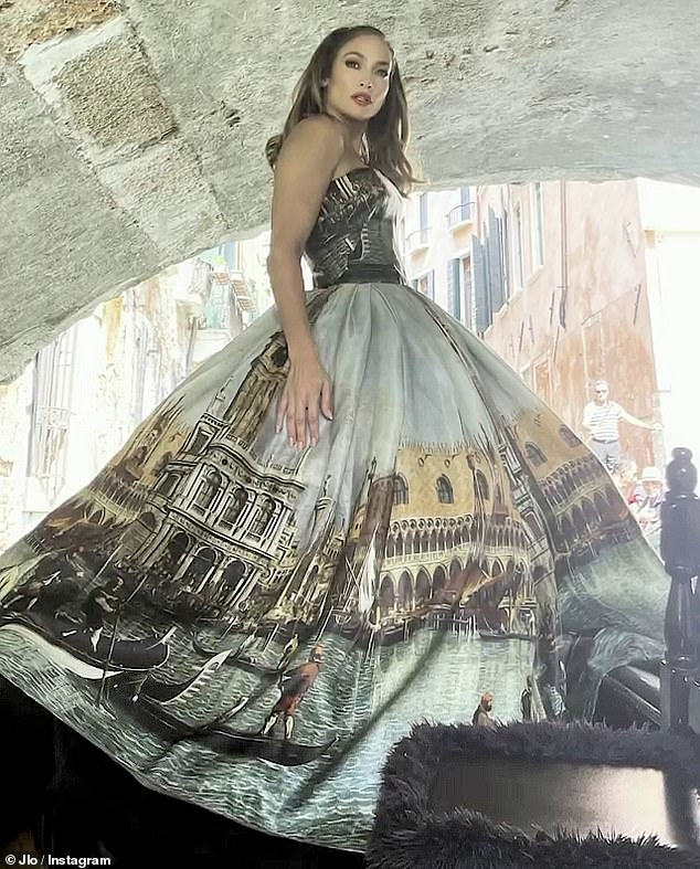 Showstopper:The Bronx native was glammed up to look like a Golden Age movie star as she wore a strapless Dolce & Gabbana gown while posing on a gondola in Venice, Italy as the song I've Been Thinkin' played