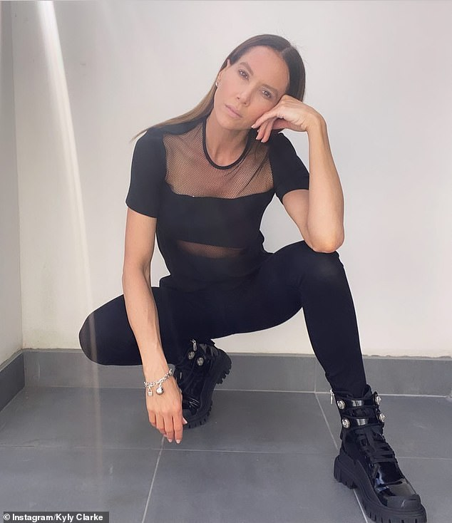 Fabulous and free at 40! Kyly Clarke pared back the makeup for an edgy modelling shoots she posted on Instagram on Wednesday