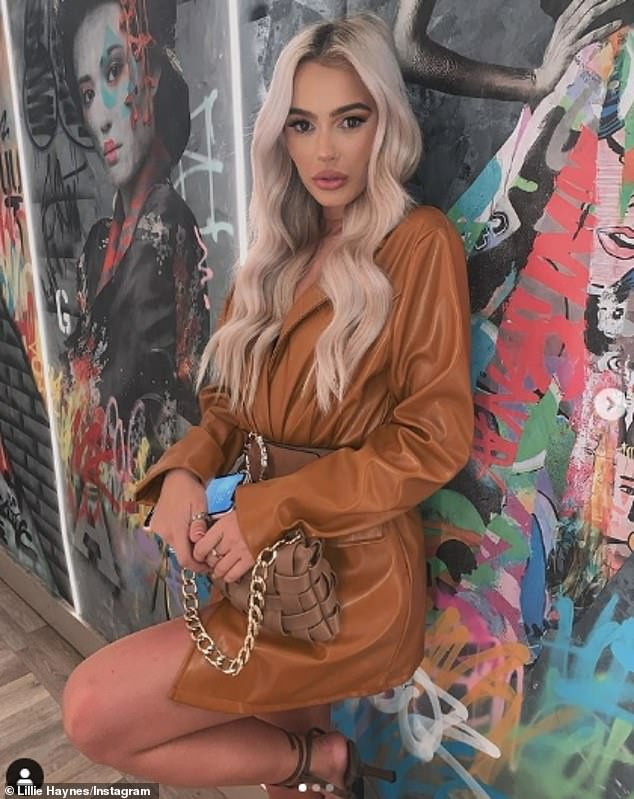 Strike a pose: Taking to Instagram after her arrival at the bar, Lillie shared a snap of herself in her outfit as she posed against a colourfully graffitied wall