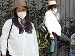 Freida Pinto drapes her baby belly in white before heading off on a trip with fiancé Cory Tran