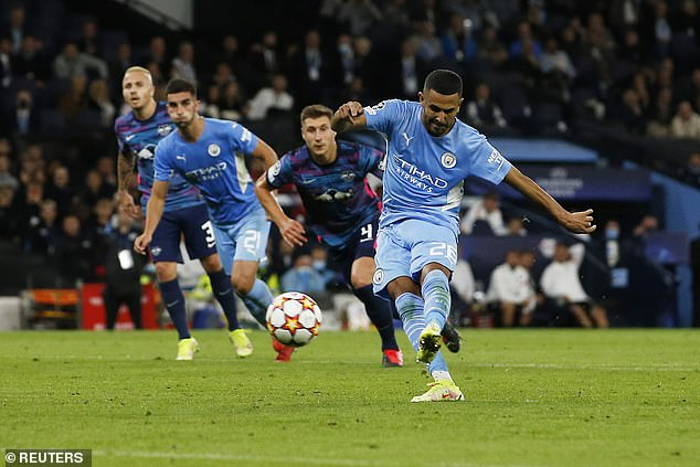 Mahrez (right) put City 3-1 up with a penalty in the first-half after Lukas Klostermann's handball
