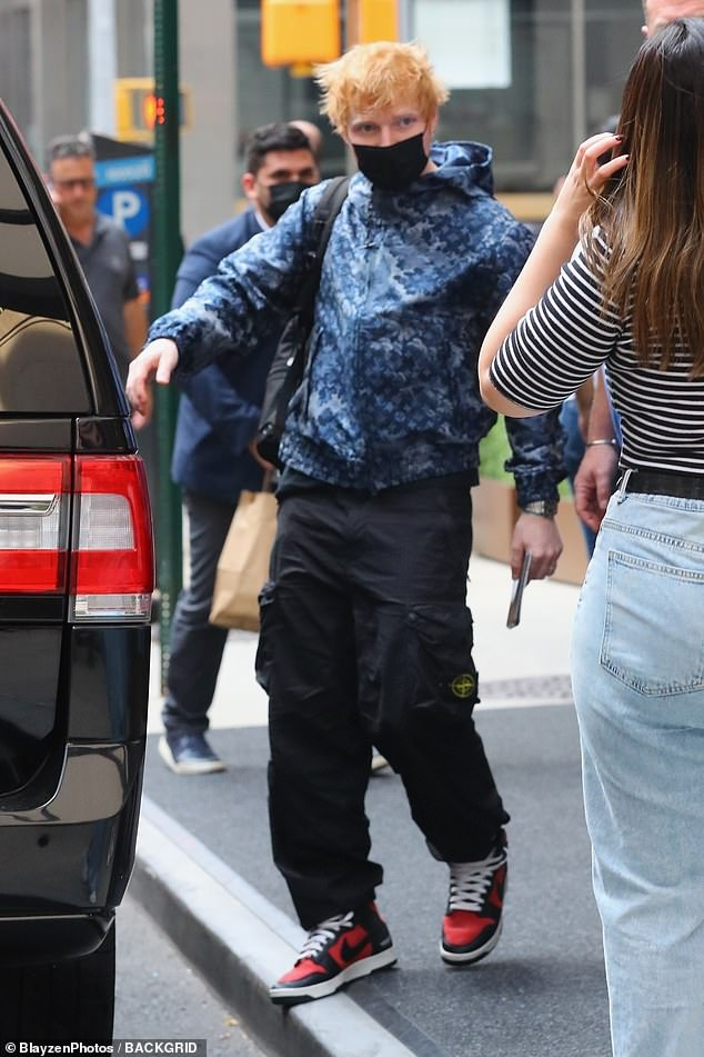 Time for fans: Ed Sheeran, 30, paused for some selfies with adoring fans on Wednesday as he check out of his hotel in New York City. He played at the 2021 MTV VMAs on Sunday