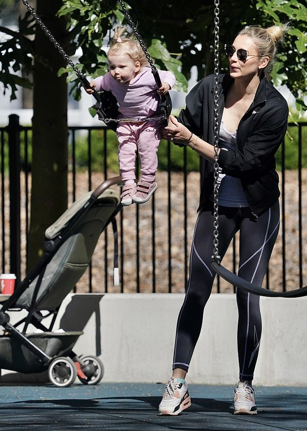 Chic activewear: For her outing, Jasmine, 37, wore black leggings, a grey tank and a black sports jacket