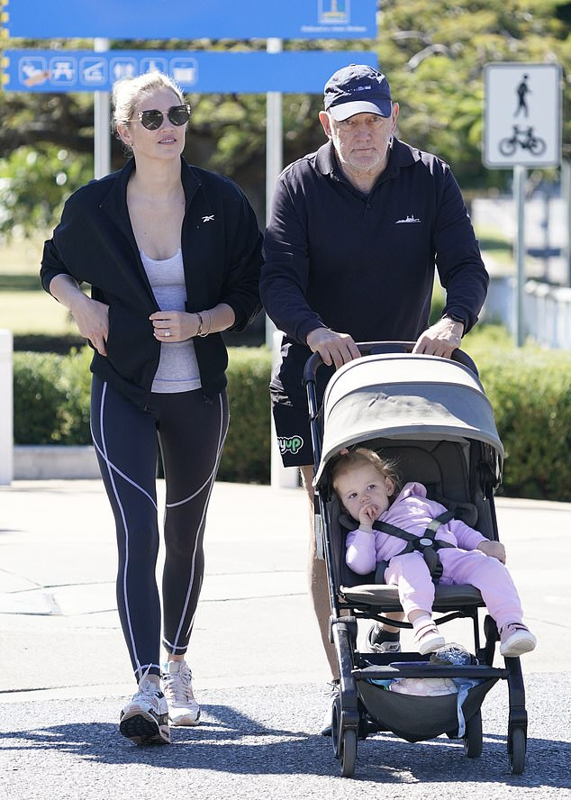 Daddy-daughter time: Her father Bob opted for an all-black ensemble and a pair of white Nike trainers, too