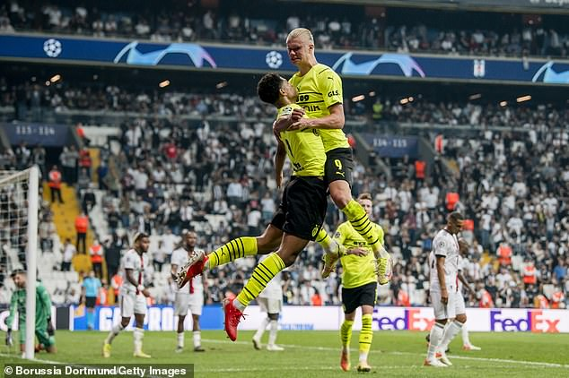 Haaland (right) celebrates with Bellingham after scoring Dortmund's second goal of the night