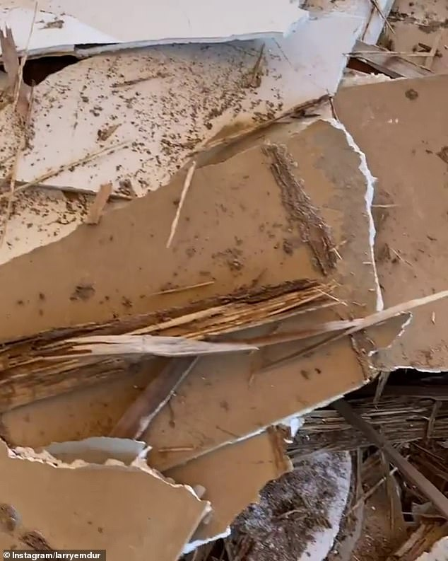 Messy: 'Now the ceiling is on the floor, where else would the ceiling be?' Larry continued as he pointed the camera to a big pile of rubble in one of the rooms