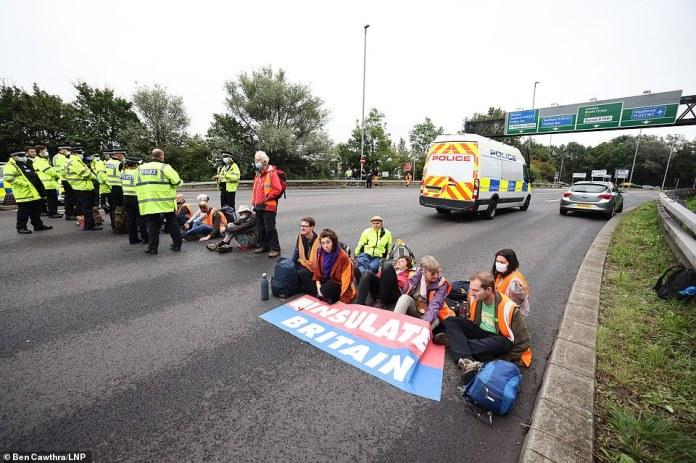 Protesters from the group Insulate Britain blockade the M25 at Junction 23 for the A1 this morning