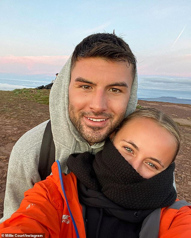 Sweet: Liam Reardon looked cosy on a hiking trip up highest peak in south Wales Pen y Fan with his girlfriend Millie Court on Wednesday as he returned to his hometown