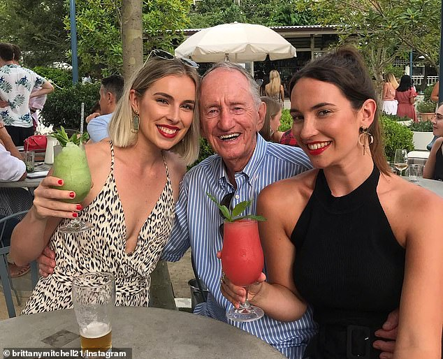 Sydney sisters Brittany (pictured left) and Olivia (right) Mitchell have built their own DIY Covid hospital ward for their 94 year old grandfather Ted Cavanagh (centre) after he was turned away from his nursing home for catching the virus