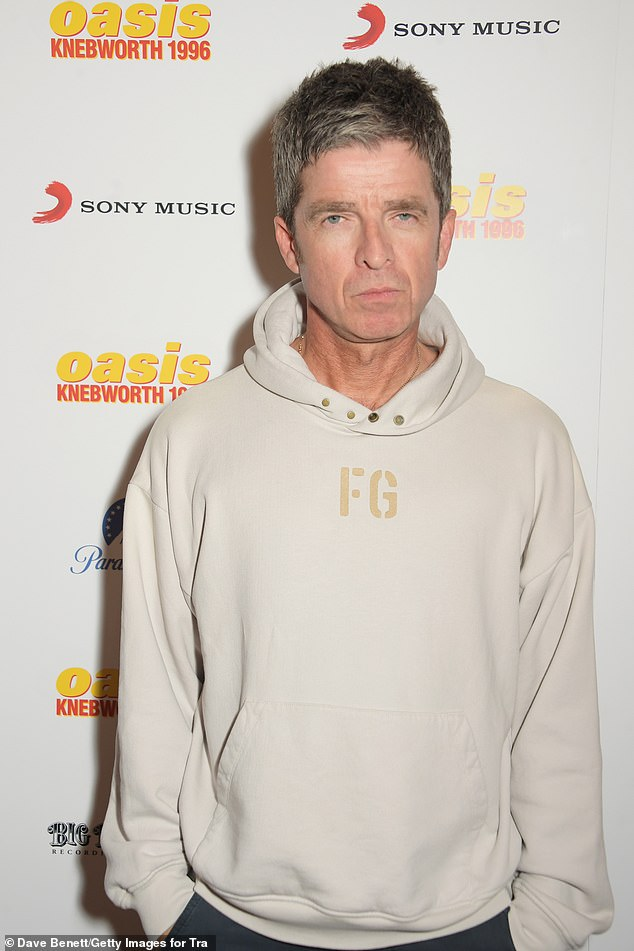 Down to earth: The musician kept it casual in a Fear of God hoodie and a pair of black jeans as he posed for pictures at the event
