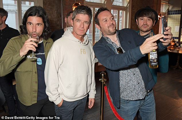 Posing up: Noel posed for pictures with a fan using his phone, while the videos used in the film were from a time when people didn't have cameraphones