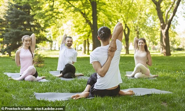 Bosses should involve employees in small talk and offer them free yoga or meditation classes to protect their mental health at work, suggest official guidelines [Stock image]