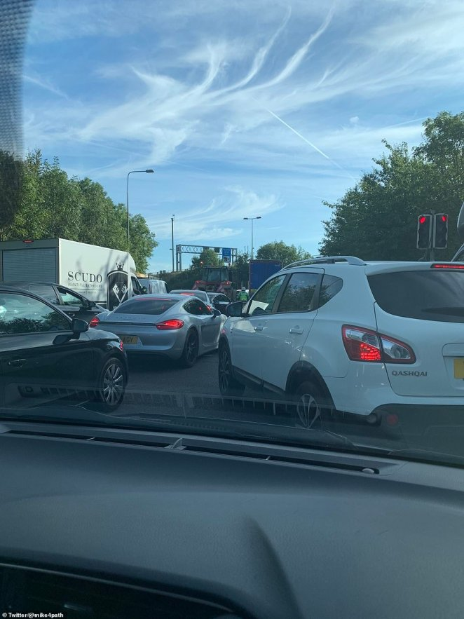 But Surrey Police failed to stop them doing the same for the third morning, with a group now sitting on the junction 9 (pictured) sliproad with long queues already building on the main carriageway
