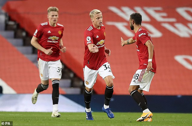 But Van de Beek quickly became a forgotten man at Manchester United, despite scoring on his debut against Crystal Palace (above)