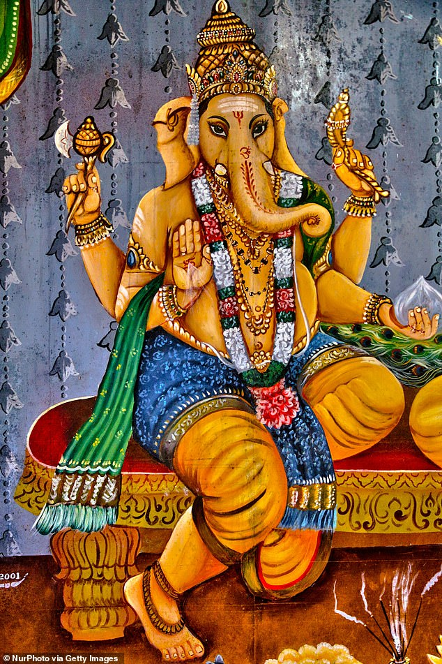 Ganesha is usually presented with four arms, an ax in his upper right hand, a noose in his upper left hand and sweet dumplings in his lower left.  His broken tooth is often shown on his lower right side, although sometimes his hand is extended to the viewer in a posture of wisdom.