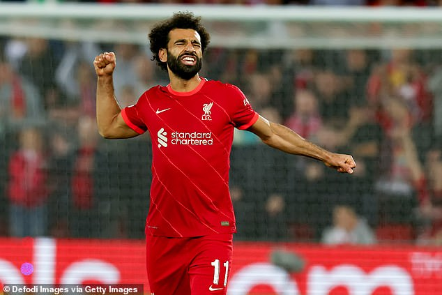 The Egyptian star celebrates during Liverpool's 3-2 win over AC Milan on Wednesday night