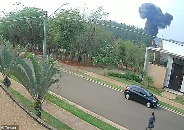 A cloud of smoke is captured by a security camera after a jet with seven people on board crashed moments after taking off from Pedro Morganti Municipal Airport in Piracicaba, Brazil on Tuesday