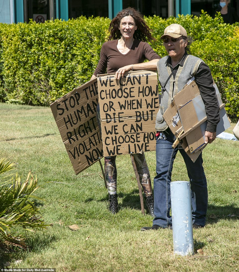 Other Byron Bay local held signs which stated 'We can't choose how or when we die - but we can choose how we live'