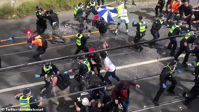 On a failed day of nationwide anti-lockdown protests, the wildest scenes were in Melbourne, where hooligans bashed police in a vicious confrontation at Richmond. At the top of the photo one man can be seen fighting with an officer