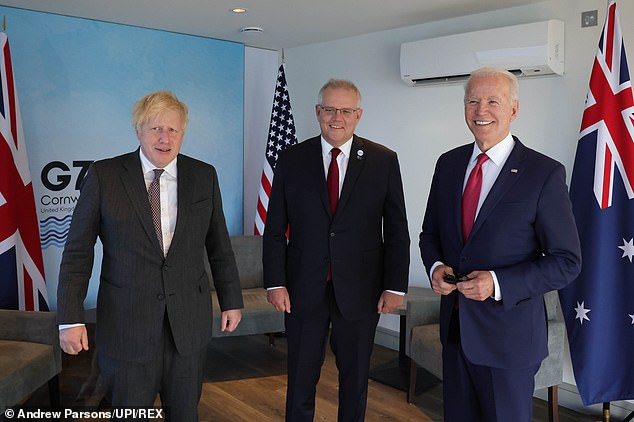 Pictured left-to-right: Boris Johnson, Australian Prime Minister Scott Morrison and US President Joe Biden at the Carbis Bay Hotel during the G7 Summit in Cornwall in June