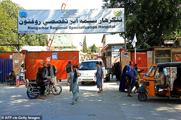 Three explosions shook the eastern provincial capital of Jalalabad on Saturday in attacks on Taliban vehicles, although most of the victims were civilians according to local media (pictured, Nangarhar Regional Specialization Hospital where the victims are being treated)