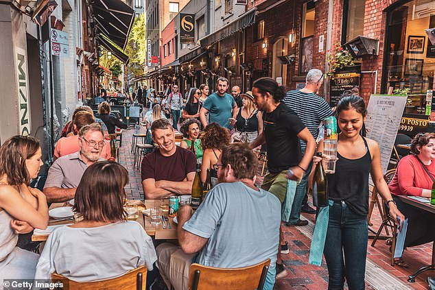 Victorians can expect to dine outdoors at pubs and restaurants next month while students can return to school as Premier Daniel Andrews unveils his road map out of lockdown (pictured in Melbourne)