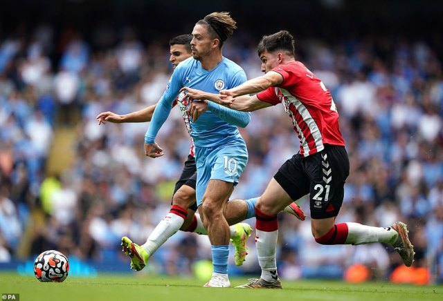 Jack Grealish battles for possession with Southampton defender Tino Livramento during the second-half at the Etihad