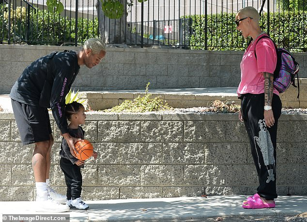See you later!  Their son Slash threw his mini basketball with his dad before saying