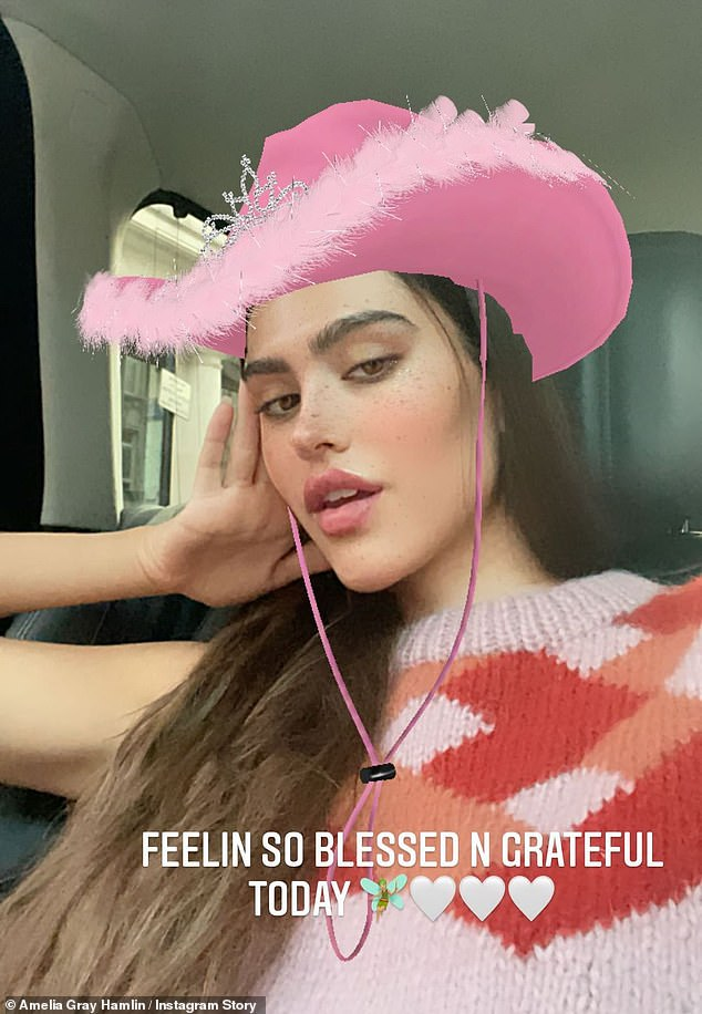 Grateful: Later adding a fun cowboy-themed filter, Amelia posed in the back of a car and told fans that she