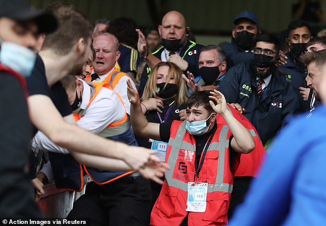 Stewards struggle to keep rival supporters apart as tensions rise in Lancashire