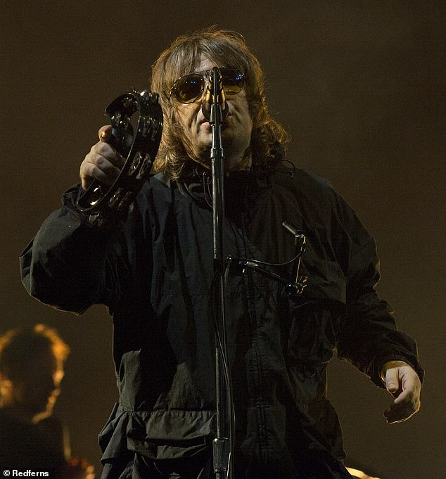 Showman: Looking always cool in a pair of aviator sunglasses under a tousled head of brown braids, the Mancunian certainly didn't disappoint as he sang his beloved pieces in a black windbreaker (photo by 2021)