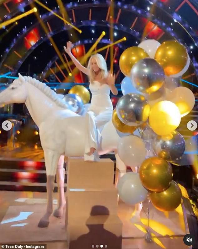 Riding: The host Strictly looked overjoyed to be back in the studio as she rode a plastic white horse surrounded by balloons in the middle of the dancefloor