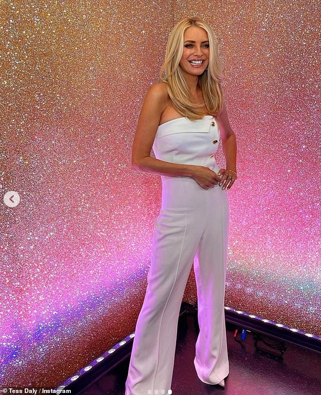 Nice to be back: Tess Daly showed off her stunning figure in a strapless white jumpsuit as she kicked off the new season of Strictly Come Dancing on Saturday night.